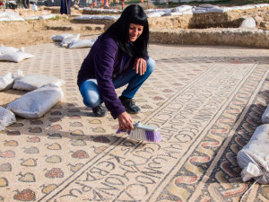 Cleaning the mosaic floor in the prayer hall of a Byzantine monastery in the northern Negev